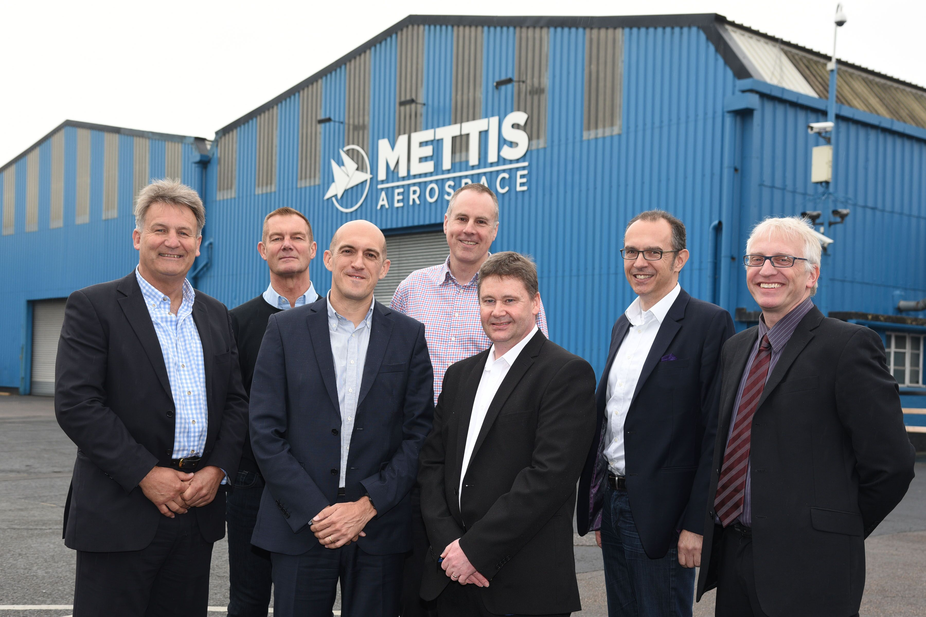 Executives and partners of the Mettis Aerospace's facility in Redditch, UK.